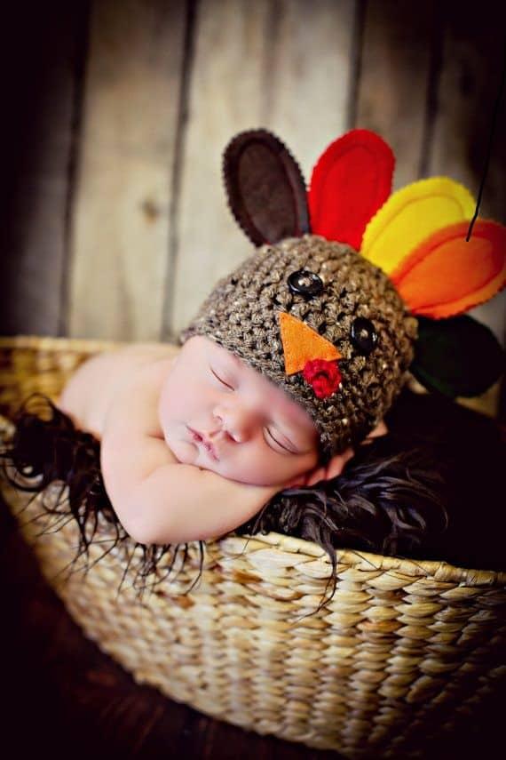newborn baby sleeping in basket on thanksgiving