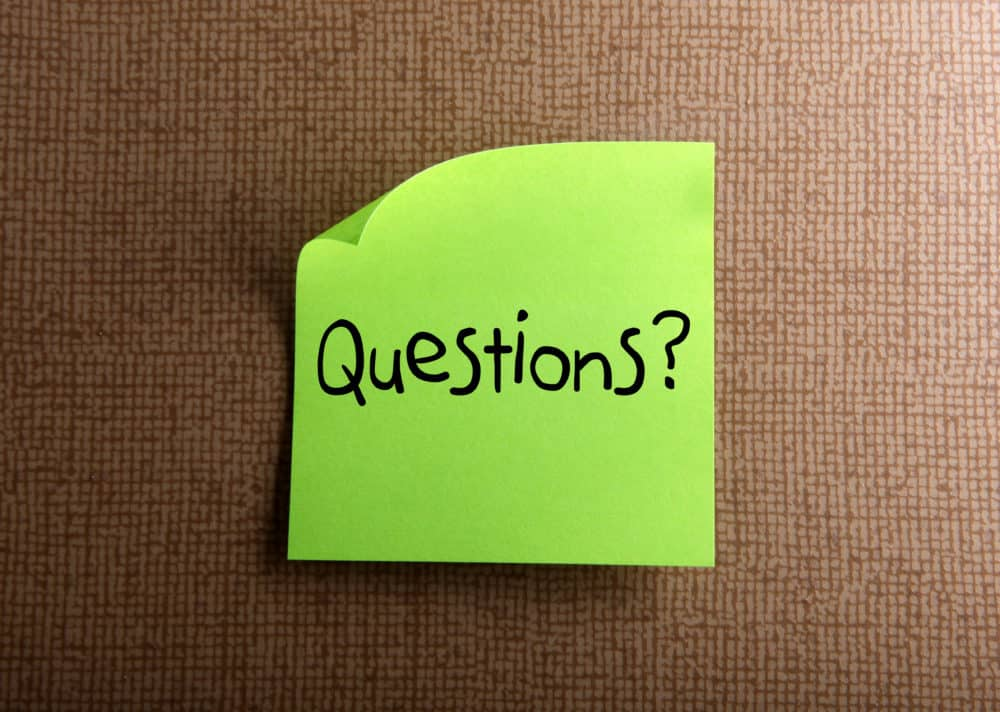 """questions"" green sticky note"