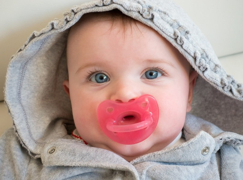 baby girl with pink pacifier