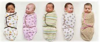 5 newborn babies sleeping in swaddle me swaddles