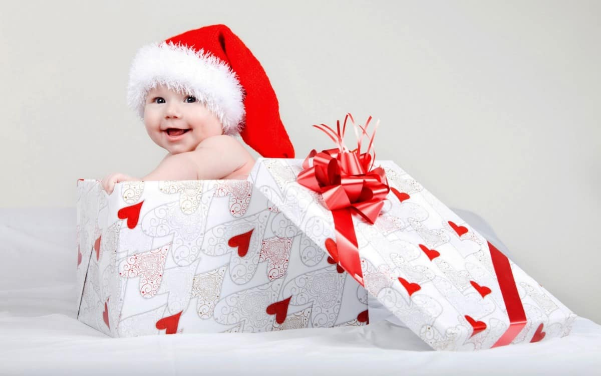 christmas baby as gift with santa hat